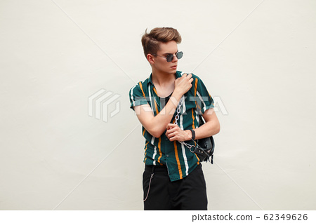 Young handsome guy in fashion beach clothes  62349626