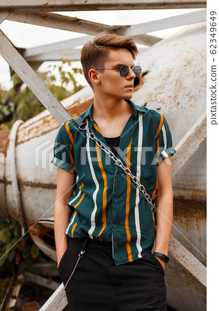 Stylish handsome young male model with sunglasses 62349649