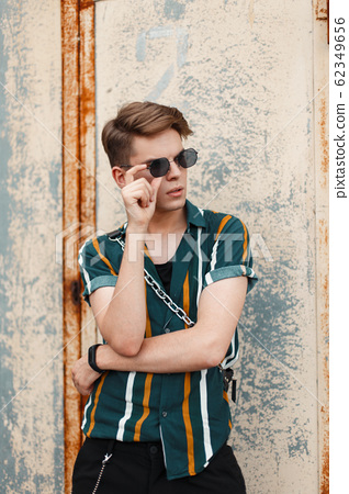 Young handsome stylish man with sunglasses  62349656
