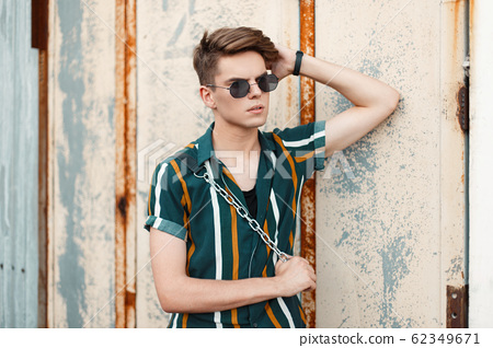 handsome young stylish man with sunglasses 62349671