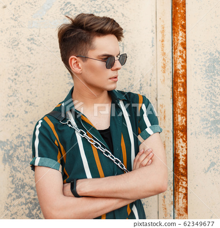 Young handsome stylish guy with sunglasses 62349677