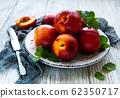 Plate with fresh nectarines 62350717