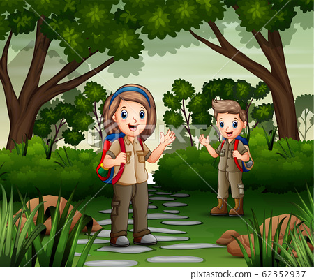 Scene with two scout hiking in the forest 62352937