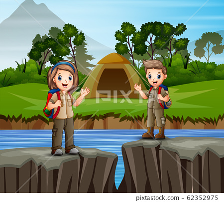 Children camping out by the river 62352975