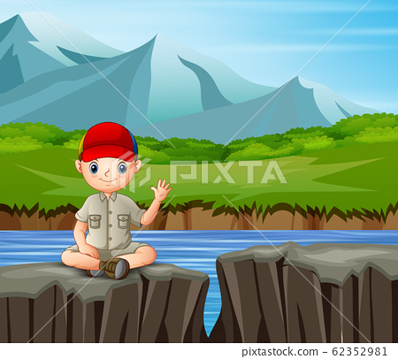 The explorer boy sitting on the cliff 62352981