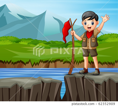 Scout boy stand on the edge of a cliff with a nature 62352989