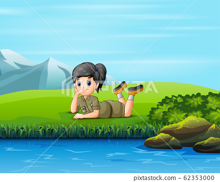 A scout girl lay down on the grass 62353000