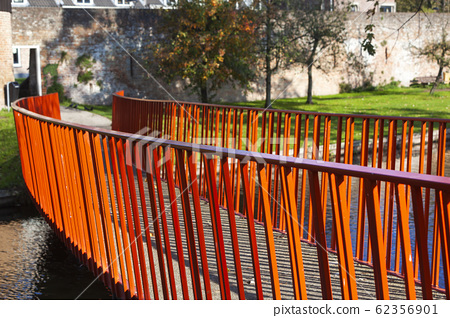 Red metal bridge to the old city wall in Vianen 62356901