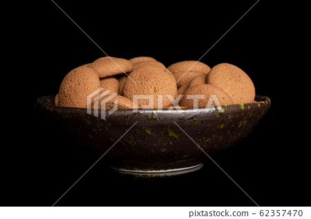 Chocolate sponge biscuit isolated on black glass 62357470