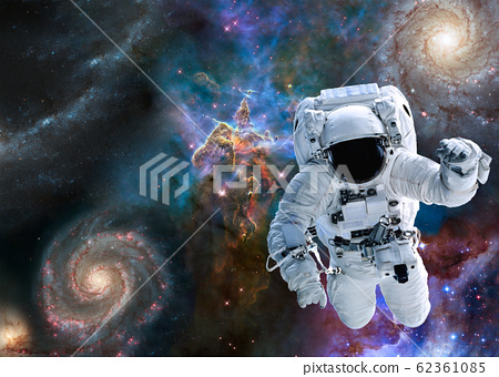 Astronaut near Mystic Mountain of Carina Nebula 62361085
