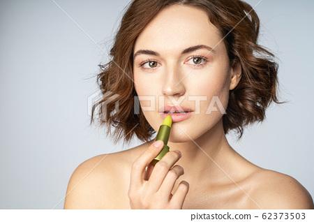 Portrait of pretty woman that posing on camera 62373503