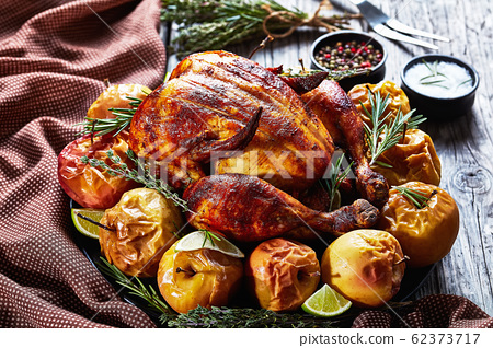 close-up of a whole roasted juicy chicken 62373717
