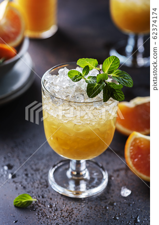Cocktail with oranges 62374174