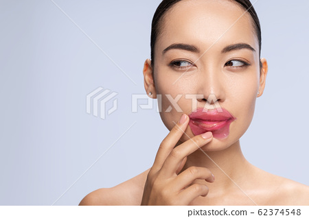 Close up of pretty girl that doing lip mask 62374548