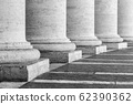 Row of white travertine columns. Colonnade of St Peters Square in Vatican City 62390362