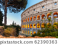 Colosseum, or Coliseum. Illuminated huge Roman amphitheatre early in the morning, Rome, Italy 62390363