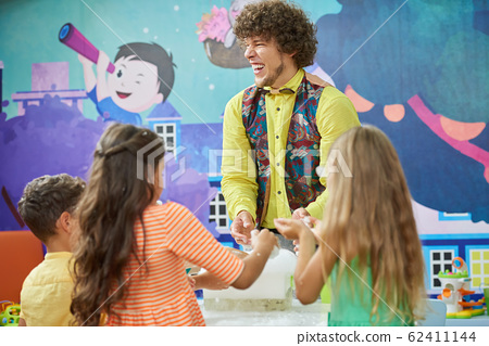 Cheerful entertainer doing science show for kids. 62411144