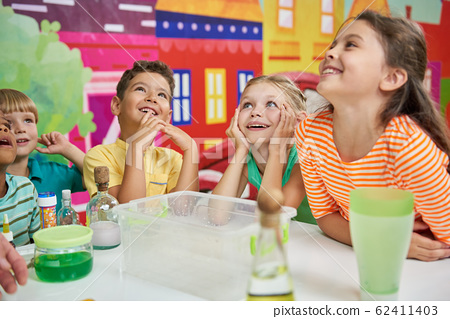 Happy kids having fun in playroom. 62411403