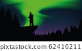 couple in love enjoy the polar lights on a cliff in the forest 62416211