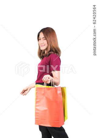 young woman pretty smiling holding paper bags 62420564