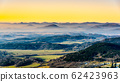 Hilly landscape on sunny and foggy day. Weather inversion. Central Bohemian Highlands, Czech: Ceske stredohori, Czech Republic 62423963