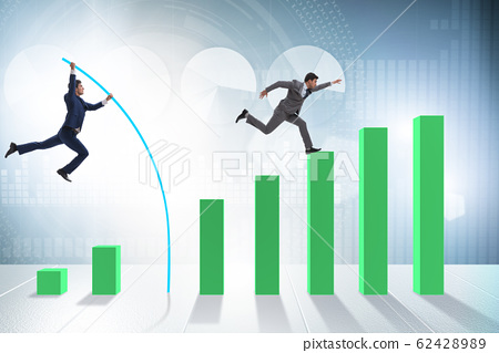 Businessman vault jumping over bar charts 62428989