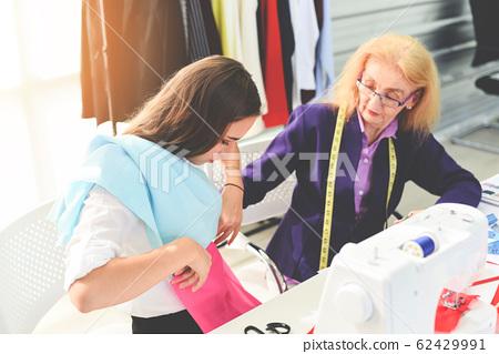 Fashion designer studio measuring textile material 62429991