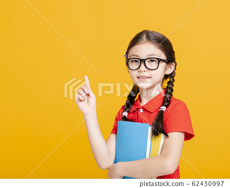 Adorable student girl  holding the books  and 62430997