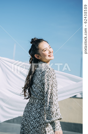 Portrait of a woman outdoors 62438589