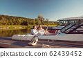 Woman and man relaxing on their river yacht 62439452