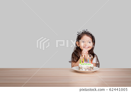 cute girl make a wish on birthday. Happy Birthday background. Greeting background for card, flyer, poster, sign, banner, web, postcard, invitation. Abstract fest background for text, type, quote 62441005
