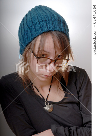 young woman with a blue winter cap 62441064