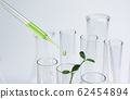 Researcher with glass laboratory chemical test 62454894