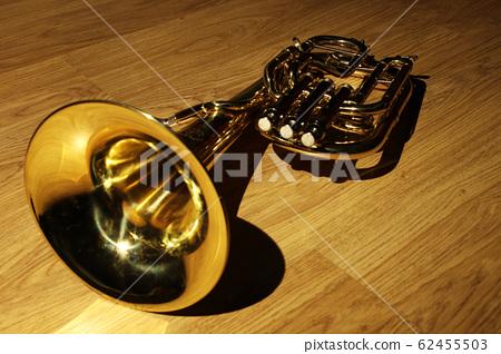 Tenor horn on wooden floor with dark background  62455503