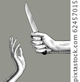 Man's hand with a knife 62457015