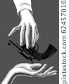 Hand holding in the fingers a gun 62457016