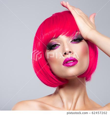 Beautiful young fashion woman with pink lipstick. 62457202