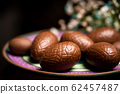 Chocolate eggs on a plate 62457487