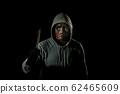 Scary killer in mask holding knife 62465609