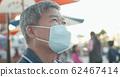 Asian elder man wears mask 62467414