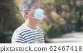 Asian elder man wears mask 62467418