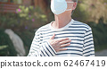 elder with protective mask 62467419