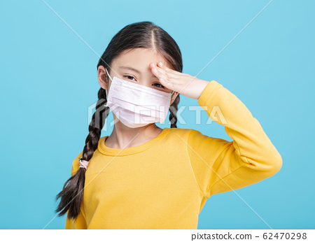 sick Girl child in medical mask isolated on blue 62470298