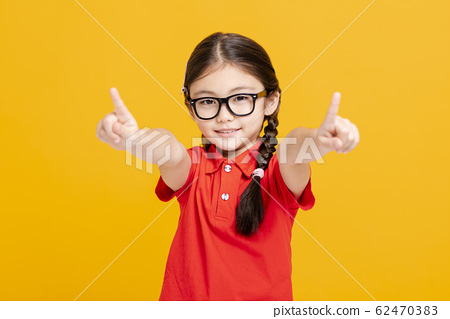 Adorable student girl  hand showing and pointing 62470383