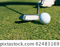 Close Up of Golf club and ball in grass. 62483169