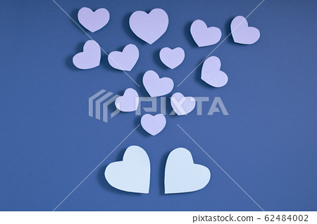 Valentine hearts on blue surface. Top view, flat lay, from above, copy space 62484002