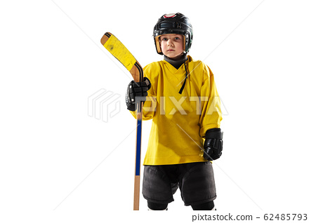 Little hockey player with the stick on ice court and white studio background 62485793