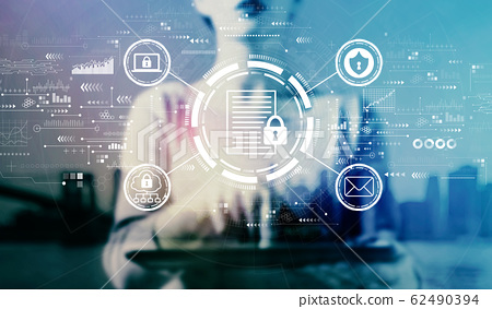 Data protection concept with businesswoman using a tablet 62490394