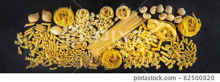 Italian pasta panorama, a flat lay texture of many different pasta kinds, shot from the top on a black background 62500820