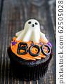 Variety of Halloween cupcakes on wooden. 62505028